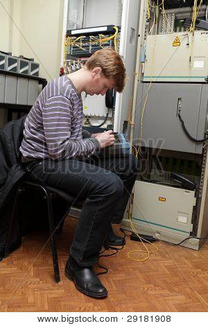 Network Technician Measuring Fiber Optic