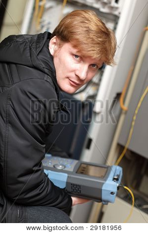 Portrait Of Technician With Reflectometer