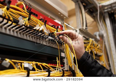 Technician Attaching Fiber Optic