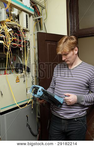Technician Measuring Fiber Optic