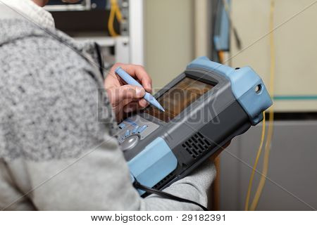 Telecom Technician Adjusting Reflectometer