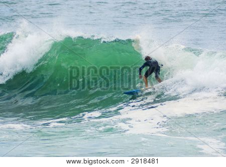 Surfer Surfs Big Wave