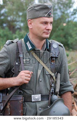 CHERNIGOW, UKRAINE - AUG 29: Member of Red Star military history club wears historical German uniform during historical reenactment of WWII, August 29, 2010 in Chernigow, Ukraine