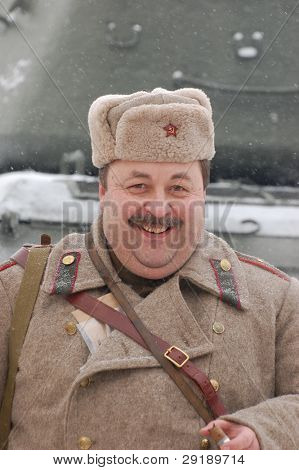 KIEV, UKRAINE - FEB 20: A member of military history club RedStar  wears historical Soviet uniform  during historical reenactment of WWII,February 20, 2011 in Kiev, Ukraine