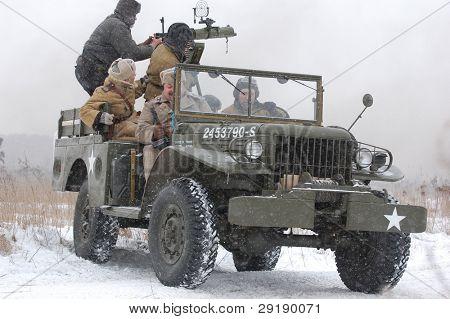 KIEV, UKRAINE - FEB 20: Members of military history club RedStar wear historical Soviet uniform during historical reenactment of WWII on February 20, 2011 in Kiev, Ukraine