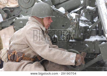 KIEV, UKRAINE - FEB 20: Member of military history club RedStar wears historical Soviet uniform during historical reenactment of WWII,February 20, 2011 in Kiev, Ukraine
