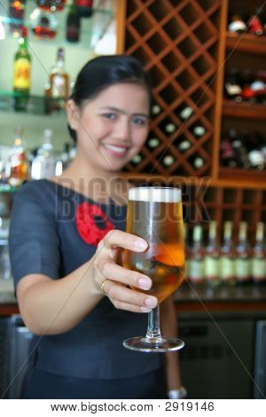 Bartender Giving The Beer