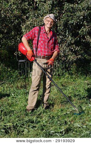 Man mowing grass.Ukraine