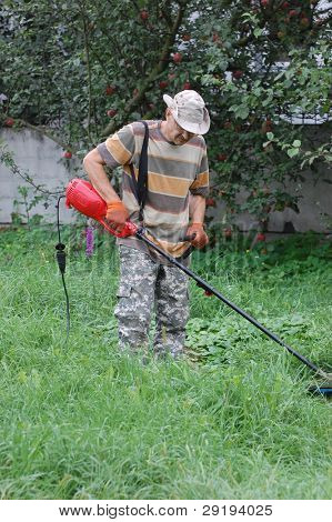 Man mowing grass.Ukraine