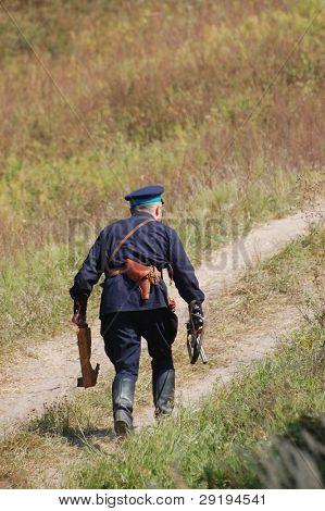 KIEV, UKRAINE -SEPT 17 : A member of Red Star history club wears historical Soviet Police (Militia) uniform during historical reenactment of WWII, September 17, 2011 in Kiev, Ukraine