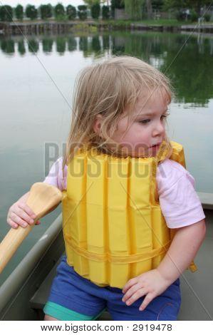Girl In Life Vest On Lake