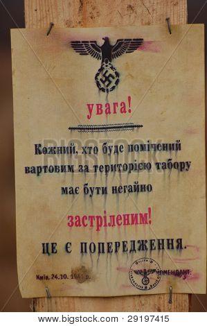 KIEV, UKRAINE -NOV 6: Nazi poster replica in Ukrainian (Translation - Restricted area.No trespass.Civilian will executed) during historical reenactment of WWII, November 6, 2011 in Kiev, Ukraine