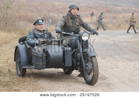 KIEV, UKRAINE -NOV 6: Unidentified members of Red Star history club wear historical German uniform during historical reenactment of WWII, November 6, 2011 in Kiev, Ukraine