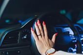 Womans Hands On The Steering Wheel Driving Modern Luxury Car. Concept Woman Driving. Hands Holding S poster