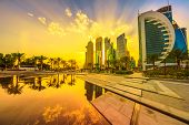 Scenic Cityscape Of Doha West Bay Skyline At Sunset Light Reflecting In The Water Of Downtown Park.  poster