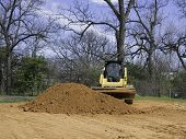 Skid Steer Loader Getting Dirt From Dirt Mound poster