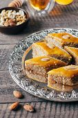 Baklava. Ramadan Dessert. Traditional Arabic Dessert With Nuts And Honey, Cup Of Tea On A Wooden Tab poster