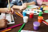 Closeup Of Children Painting Pictures, Focus On Art Supplies Paints, Pencils And Crayons, Copy Space poster