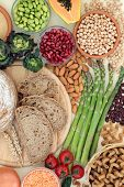 High fibre super food with whole wheat pasta, whole grain rye bread, fruit, vegetables, legumes, gra poster