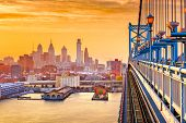 Philadelphia, Pennsylvania, USA downtown skyline from the Benjamin Franklin Bridge at twilight.  poster