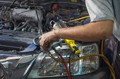 Auto Mechanic Fixing Air Condition In Garage . Monitoring Tools Check Car Air Conditioner System. V poster