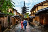 Kyoto, Japan Culture Travel - Asian Traveler Wearing Traditional Japanese Kimono Walking In Higashiy poster