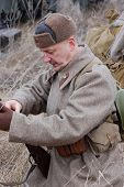stock photo of vinnitsa  - Person in Soviet uniform as he participates in a WWII reenactment - JPG