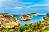 The Great Ocean Road of Australia. The Pacific ocean. Small picturesque bay with green ocean water.  poster