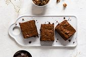 Chocolate Brownie Cake, Dessert With Nuts On Dark Background, Directly Above poster