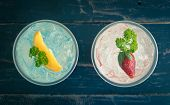 Blue Red Italian Soda Cold Beverage And Lemon Strawberry Fruit And Parsley. Blue Red Italian Soda Co poster