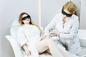 The Girl Is Lying On The Couch In The Medical Glasses In The Treatment Room. The Hands Of The Cosmet poster