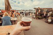 Craft Beer Glass In Drinker Hand On Street Food Market Of Copenhagen, Denmark. Leisure In Scandinavi poster