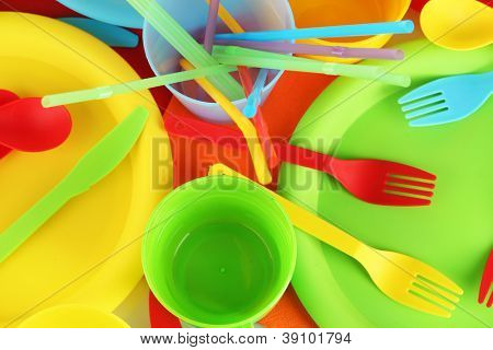 bright plastic disposable tableware close-up