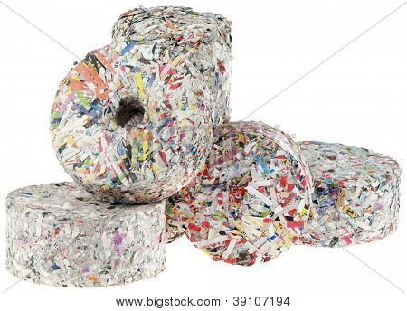 Briquette made of Paper Strips Isolated on White Background