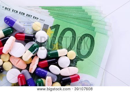 Pills and money, concept expensive drugs