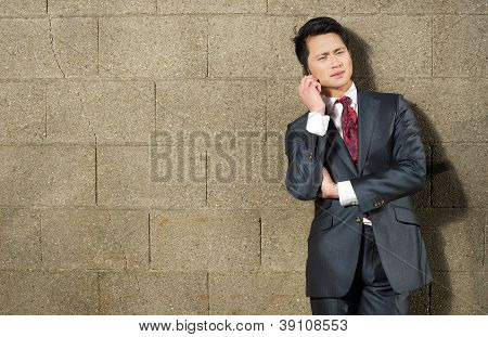Portrait Of A Young Businessman On Phone