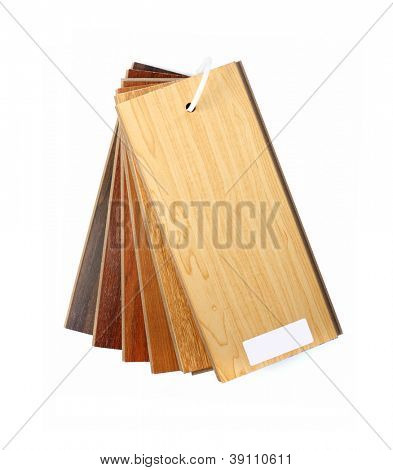 Sample pack of wooden flooring laminate isolated on white background