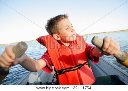 Boy Rowing his own boat