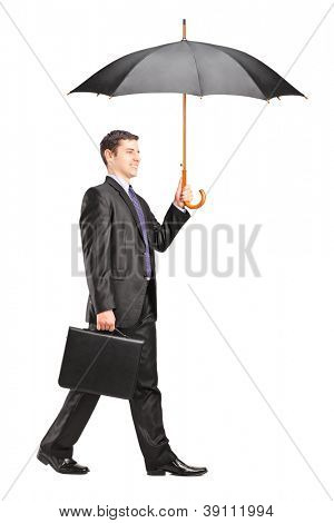 Full length portrait of a man holding an umbrella and briefcase isolated on white background