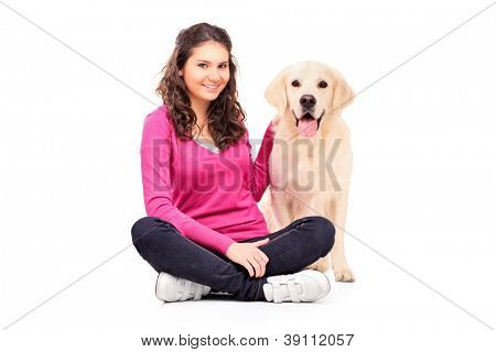 Young female posing with a dog isolated on white background