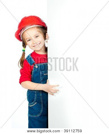 smiling little girl in the construction helmet with a white board