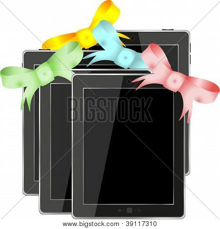 Tablet Pc ipad Set With Ribbons And Bow Isolated On A White