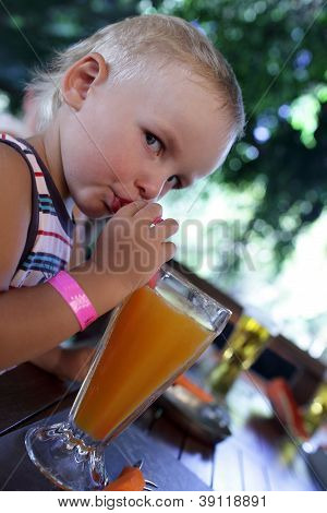 Serious Kid Drinking Fresh Juice