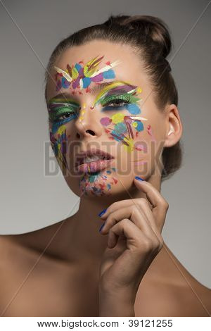 Beauty Portrait Of Girl With Creative Make-up And Hand Near The Chin
