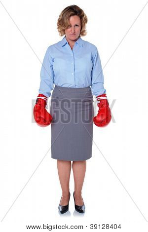 Photo of a businesswoman wearing boxing gloves, isolated on a white background.