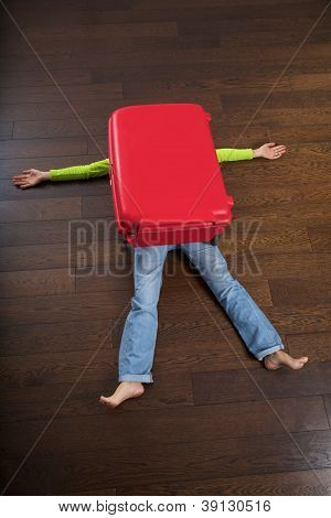 Traveler Crushed By Red Suitcase