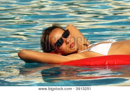 Woman Swimming On An Air Matress