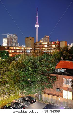 Toronto urban buildings over park with blue sky at night