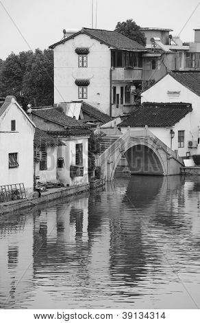 Shanghai Zhujiajiao town with historic buildings over river in black and white