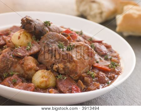 Conejo pan Chorizo guiso con cebolla de botón